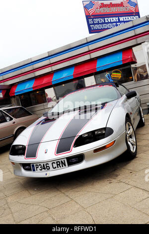 A silver fourth generation Chevrolet Camaro sports coupe from the late 1990's at a classic car meet in Great Yarmouth. - Stock Photo