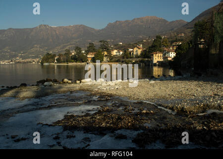 View on mountains from Sulzano on Iseo lake in Italy - Stock Photo
