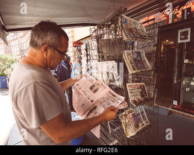PARIS, FRANCE - JUL 16, 2018: Smoking man buying  newspaper announcing France champion title after French national football team won their FIFA World  - Stock Photo
