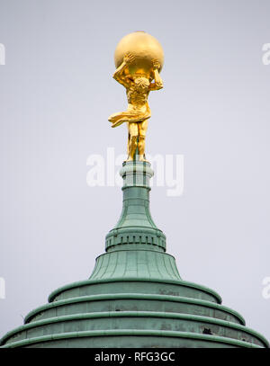 Golden statue of Atlas in Potsdam, Germany - Stock Photo