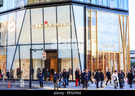 The Ginza, daytime. People waiting for the crossing light countdown at zebra crossing in front of the Bally fashion store in the Tokyu Plaza building. - Stock Photo