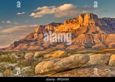 Western escarpment of Guadalupe Mountains at sunset, Chihuahuan Desert, Guadalupe Mountains National Park, Texas, USA - Stock Photo