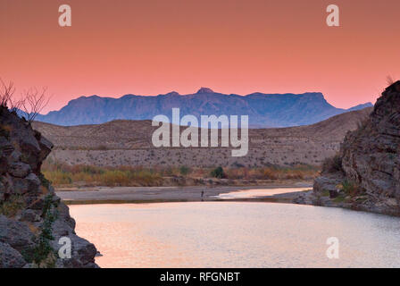 Chisos Mountains seen over Rio Grande from Santa Elena Canyon at sunset, Chihuahuan Desert in Big Bend National Park, Texas, USA - Stock Photo