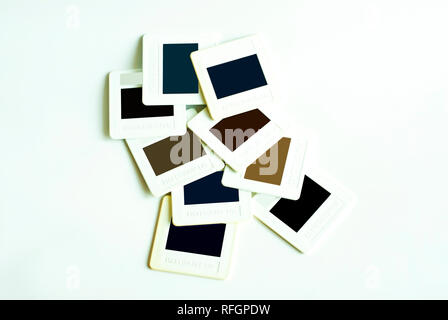 Set of old reversal film in plastic frame mounting - Stock Photo