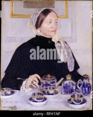 Lady at the Tea Table. Artist: Mary Cassatt (American, Pittsburgh, Pennsylvania 1844-1926 Le Mesnil-Théribus, Oise). Dimensions: 29 x 24 in. (73.7 x 61 cm). Date: 1883-85.  This work shows Mary Dickinson Riddle, Cassatt's mother's first cousin, presiding at tea, a daily ritual among upper-middle-class women on both sides of the Atlantic. Mrs. Riddle's hand rests on the handle of a teapot, part of a gilded blue-and-white Canton porcelain service that her daughter had presented to the artist's family. Painted in response to the gift, the portrait demonstrates Cassatt's mastery of Impressionism i - Stock Photo