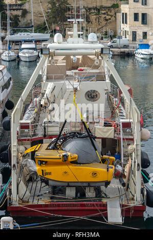 mini submarine on the stern of a vessel moored in Valletta, Malta. - Stock Photo
