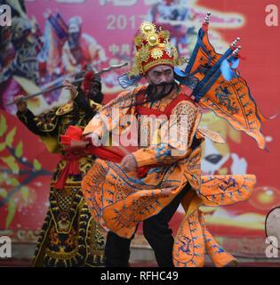 Qiannan, China's Guizhou Province. 25th Jan, 2019. Villagers rehearse for folk play performance celebrating the Spring Festival in Changchong Village of Longchang Township in Bouyei-Miao Autonomous Prefecture of Qiannan, southwest China's Guizhou Province, Jan. 25, 2019. Credit: Cai Xingwen/Xinhua/Alamy Live News - Stock Photo