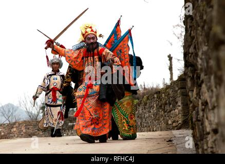 Qiannan, China's Guizhou Province. 25th Jan, 2019. Villagers walk to the stage before rehearsal for folk play performance celebrating the Spring Festival in Changchong Village of Longchang Township in Bouyei-Miao Autonomous Prefecture of Qiannan, southwest China's Guizhou Province, Jan. 25, 2019. Credit: Yi Shengwu/Xinhua/Alamy Live News - Stock Photo