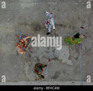 Qiannan, China's Guizhou Province. 25th Jan, 2019. Aerial photo shows villagers rehearsing for folk play performance celebrating the Spring Festival in Changchong Village of Longchang Township in Bouyei-Miao Autonomous Prefecture of Qiannan, southwest China's Guizhou Province, Jan. 25, 2019. Credit: Cai Xingwen/Xinhua/Alamy Live News - Stock Photo