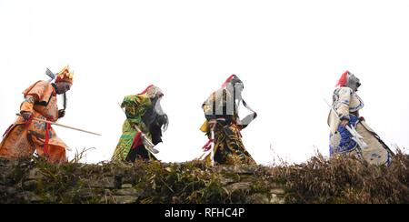 Qiannan, China's Guizhou Province. 25th Jan, 2019. Villagers walk to the stage before rehearsal for folk play performance celebrating the Spring Festival in Changchong Village of Longchang Township in Bouyei-Miao Autonomous Prefecture of Qiannan, southwest China's Guizhou Province, Jan. 25, 2019. Credit: Cai Xingwen/Xinhua/Alamy Live News - Stock Photo