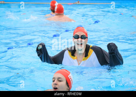 Tooting Bec, London, UK, 26th Jan 2019. The Crisis charity race. The 8th UK Cold Water Swimming Championships get under way at Tooting Bec Lido in South London. Over 700 swimmers and dippers in various categories are cheered on by the crowds, including 30-yards traditional 'head-up' breaststroke, 30m ice fly, 90m freestyle dash and the 'Big Splash' Crisis charity jump-in with over 70 hardy dippers, in aid of the homeless charity.  degrees. Credit: Imageplotter News and Sports/Alamy Live News - Stock Photo