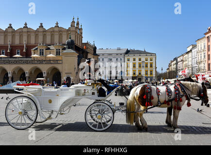 View on Main Market Square with coach, horses and coach girl - Stock Photo