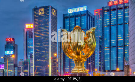 The Golden Bauhinia Square and the city skyline of tall buildings illuminated at night on Hong Kong Island,  Hong Kong, China, Asia. - Stock Photo