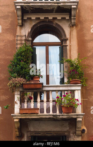 Balcony in Venice overlooking the Canal - Stock Photo