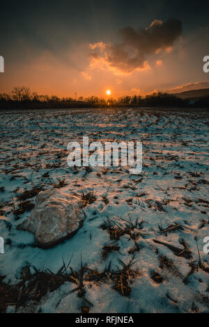 snowy winter landscape - sunset in the snow fields in lower austria - Stock Photo