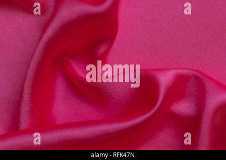 Abstract background in pink and red colors, rippled silk - Stock Photo