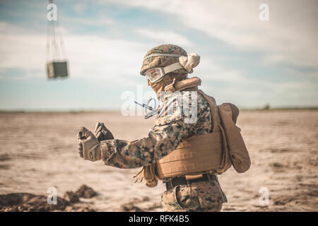 A U.S. Marine with 1st Transport Support Battalion, 1st Marine Logistics Group, leads Japanese Ground Self-Defense Force Soldiers from the training area after finishing a helicopter support team exercise for Iron Fist 2019 at Marine Corps Base Camp Pendleton, California on Jan. 22, 2019. Exercise Iron Fist 2019 is an annual, multilateral training exercise where U.S. and Japanese service members train together and share techniques, tactics and procedures to improve their combined operational capabilities. (U.S. Marine Corps photo by Sgt. Conner Robbins) - Stock Photo
