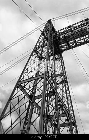 the suspension bridge of bizkaia (puente de vizcaya) between getxo and portugalete over the ria de bilbao, black and white - Stock Photo