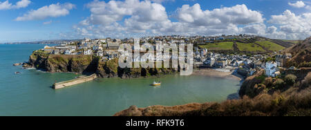 Panoramic view of the pretty fishing harbour of Port Issac in Cornwall, UK. Location for the filming of the television series Doc Martin - Stock Photo