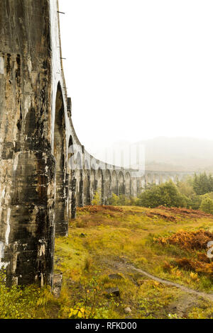 Glenfinnan Viaduct as seen from below during a hike to spot the famous steam train in autumn (Glenfinnan, Scotland, Europe) - Stock Photo