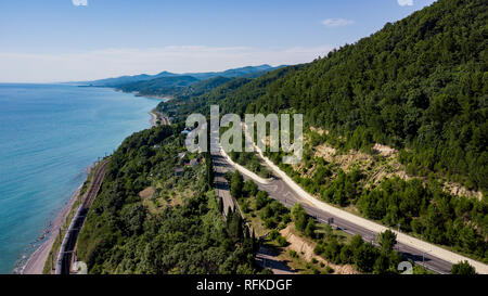 Aerial view of car driving along the winding mountain road in Sochi, Russia. - Stock Photo