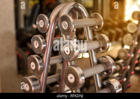 weights are in a row in the gym , - Stock Photo