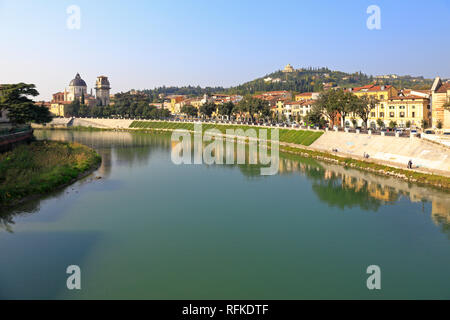 Adige River, San Giorgio in Braida and distant hilltop Sanctuary our Lady of Lourdes from the Ponte Pietra, Verona, Veneto, Italy. - Stock Photo