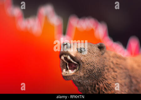 Stock crash with red chart drop in background and bear in front. Bear market trend concept. - Stock Photo
