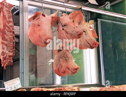 Pig Heads in Meat Market in Downtown Athens, Greece - Stock Photo