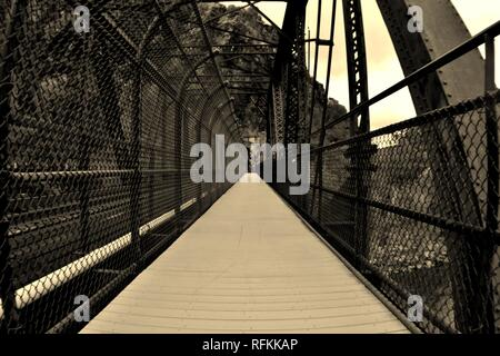 First Person Perspective walking along a bridge on the Appalachian Trail crossing from West Virginia into Maryland, USA - Stock Photo