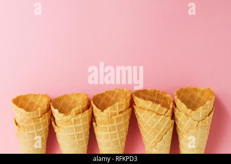 Empty Colorful Pastel Toning Ice Cream Cones on Pink Background. Minimalism. Flat Lay. - Stock Photo