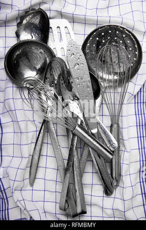 kitchen utensils on a kitchen towel - Stock Photo