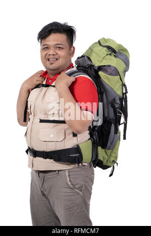 man backpacker standing look at the camera - Stock Photo