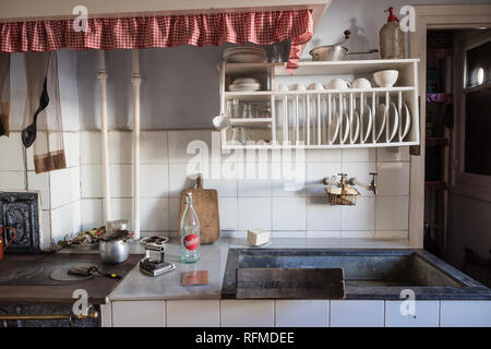 Old kitchen in a working-class neighborhood of Legazpi in the iron valley - Stock Photo