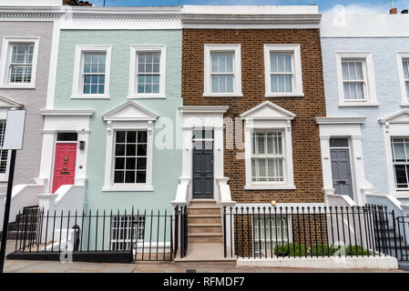 Colored row houses seen in Notting Hill, London - Stock Photo