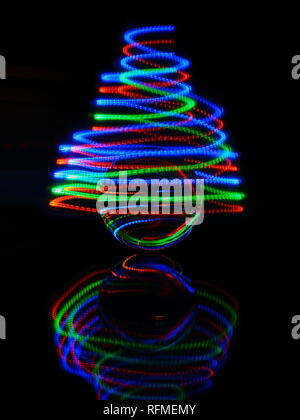 Infinity  light trails created with small torch in a spiral motion - Stock Photo