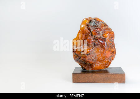 Macro Close up of an amber stones from Baltic sea. Multicoloured background for advertising and banners. Vintage fossilised resin as a background. - Stock Photo