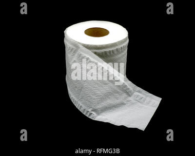 Tissue paper with roll core. Roll of toilet paper isolated on a black background. - Stock Photo