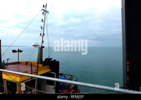 Looking out from Ryde Pier Head: the ferry, Victoria of Wight, on the horizon, sailing to Portsmouth from Fishbourne, on the Isle of Wight. - Stock Photo