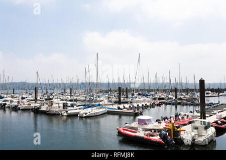 Brest, France 28 May 2018 Panoramic outdoor view of sete marina Many small boats and yachts aligned in the port. Calm water and blue cloudy sky - Stock Photo