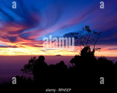Double Summit Mount Merapi and Mount Merbabu experience - Stock Photo