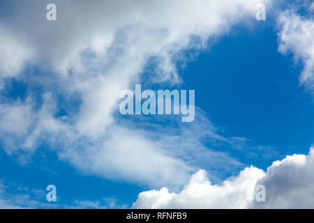Clouds gather in the clouds against the blue clear sky - Stock Photo