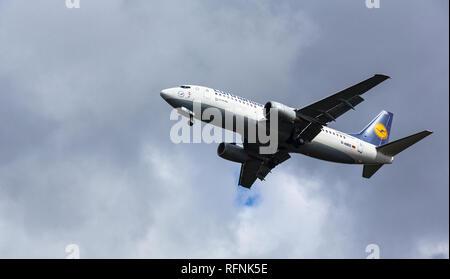 GERMANY, FRANKFURT - SEPTEMBER 06, 2015: Boeing 737-330, D-ABEE of Lufthansa flies in the sky - Stock Photo