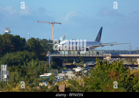GERMANY, FRANKFURT - SEPTEMBER 06, 2015: Boeing 777 of United taxis on the runway at Frankfurt Airport - Stock Photo