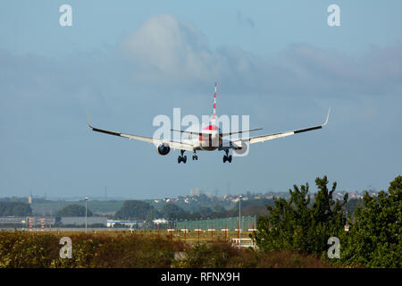 GERMANY, FRANKFURT - SEPTEMBER 06, 2015: American Airlines aircraft approach and landing at Frankfurt Airport - Stock Photo