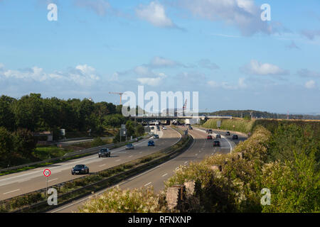 GERMANY, FRANKFURT - SEPTEMBER 06, 2015: Airbus of American taxis above the highway at Frankfurt Airport - Stock Photo