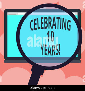 Writing note showing Celebrating 10 Years. Business photo showcasing Commemorating a special day Decennial anniversary Magnifying Glass Enlarging Tabl - Stock Photo