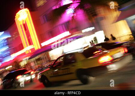 Art Deco Hotels and Bars at the Ocean Drive in the evening, Miami Beach, Florida, USA - Stock Photo
