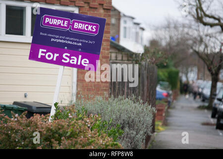 Purple Bricks online web based esate agents sign outide house in London - Stock Photo