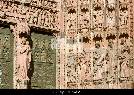 Figures from the main portal of the west façade on the cathedral of Strasbourg, France - Stock Photo